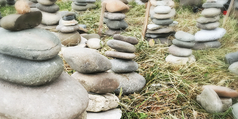 Stacked stones as a metaphor for birth stories. Photo copyright Virginia Bobro 2016